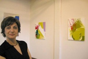 Carolanna Parlato with some of her paintings