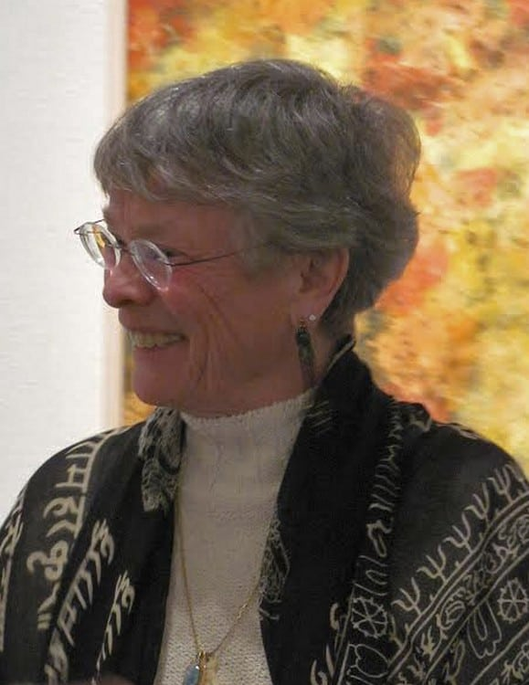 Susan Christie in front of her ink-and-gouache painting on paper, _Sunlight