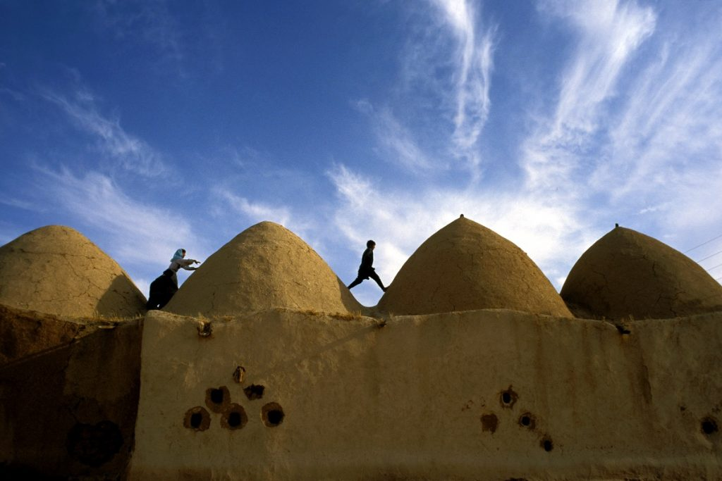 3 Children Playing among the Domed Roofs of Am Al Aboud