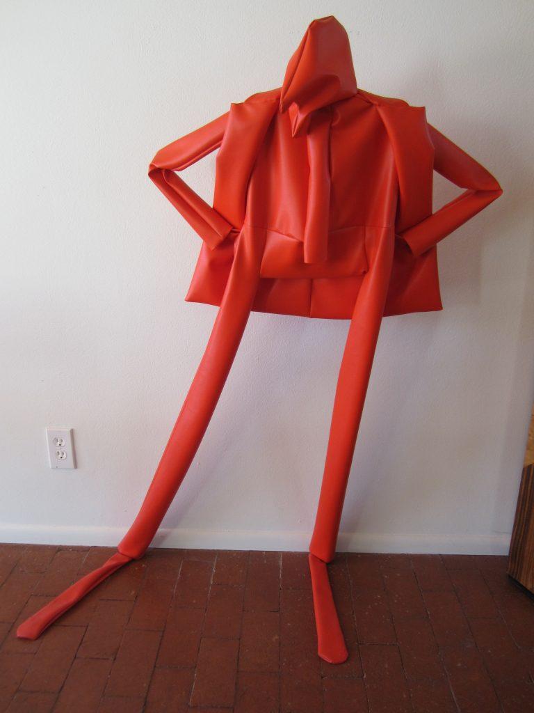 William King's orange vinyl sculpture title Bravo!