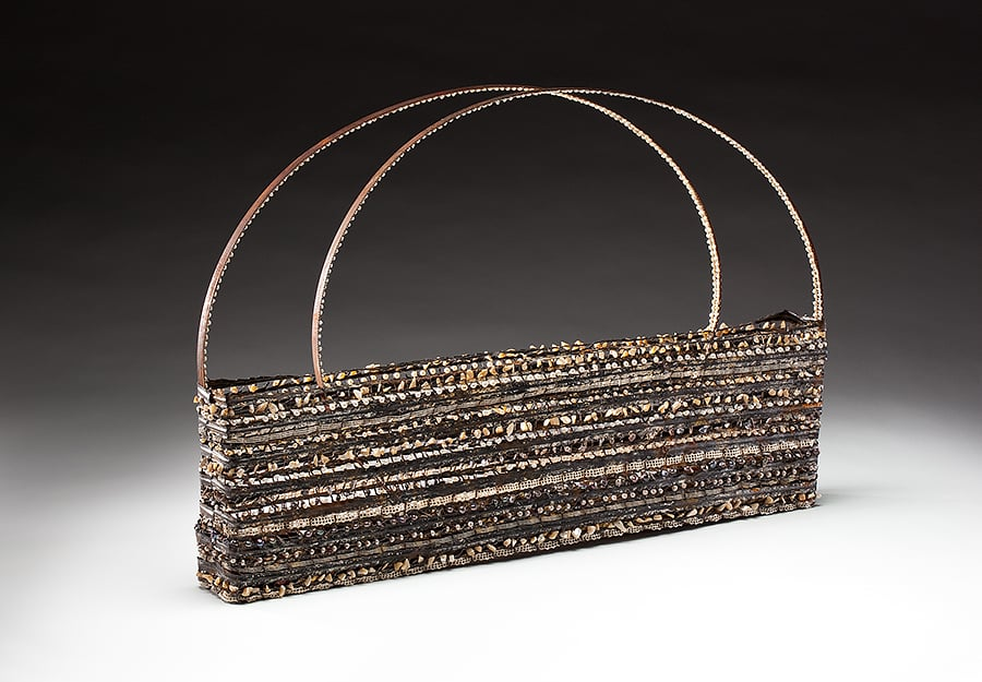 Shell Bag (2011), steel, lace, pearls, shells, bullet casings, 18 by 27.5 by 3 inches