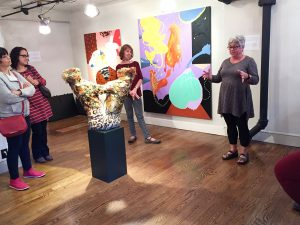 """Jodi Colella explains some of the finer points of her sculptures at the pop-up called """"Whack!"""""""
