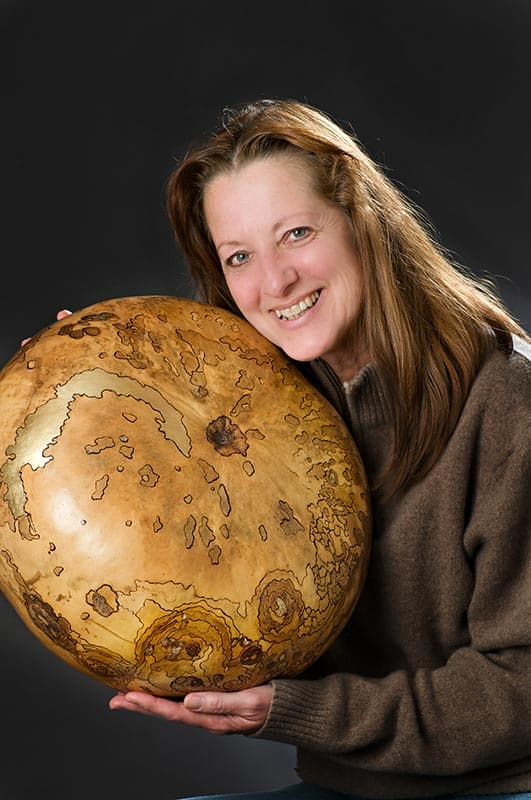 "Serena Kovalosky with one of her ""gourd"" sculptures"