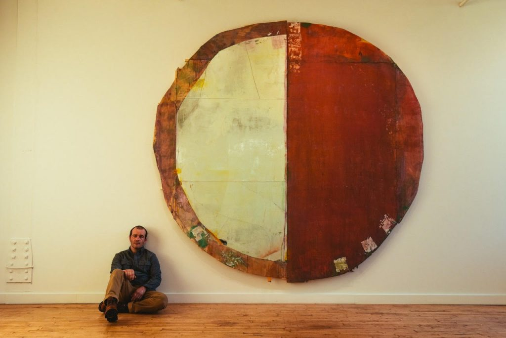 Daniel John Gadd in front of a recent large painting
