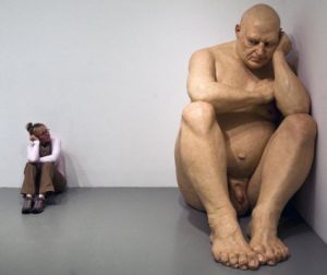 Playing with scale: A visitor confronts an outsized nude from Ron Mueck