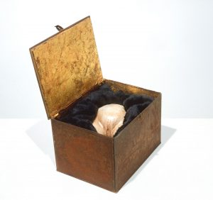 The Box (1998), resin, steel, metal leaf, acrylic, wax, and fabric, 15.5 by 11 by 8.75 inches
