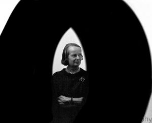 Betty Parsons framed by an Alexander Liberman sculpture