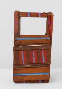 Punch and Judy Theater (1975), acrylic on wood, 8 by 9.5 by 6.5 inches