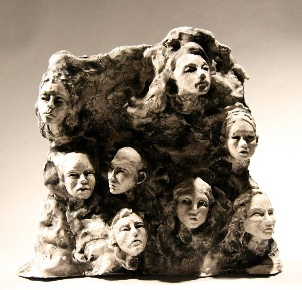 Bob Clyatt, 8-Head Composition on Slab (2009), glazed stoneware and pigments, 12 by 13 by 3 inches