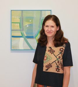 Karlyn Benson and a painting by Ky Anderson