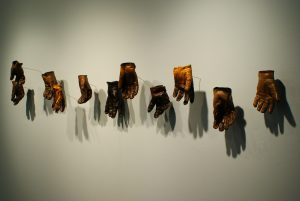 """Gloves"" (2006-2007), leather gloves, polyester resin, steel rod series of 50"