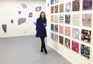Elyce Abrams, shown here at a recent solo exhibition, has sold 85 paintings in the $200-$500 range on Instagram.