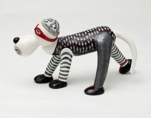 """Elizabeth Levine's Bandit is made from white earthenware, meticulously glazed. He and his colleagues in the studio, Levine says, add up to """"a humorous and endearing commentary on our pet centric culture,"""""""
