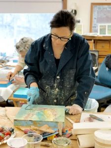 Lisa Pressman working on an encaustic painting