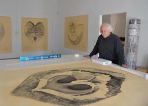 Gendron Jensen with his first large-scale drawing, I Begin Here