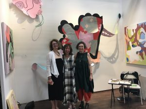 Adria Arch (center) with artist Catherine Bertulli and curator Cecily Miller