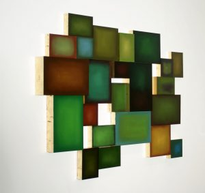"""Green: Abundance and Scarcity (2014), installation of """"Seed"""" paintings, oil/paper/wood/gold foil, various sizes"""