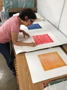 Emily Berger signing prints